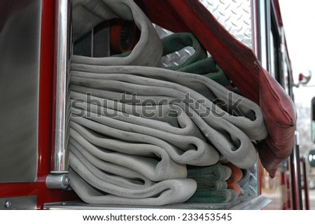 Fire Equipment stands ready at a Mid-west American, municipal fire department - FIrehouse - stock photo