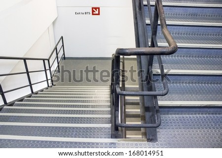 Fire escape behind a tall building - stock photo