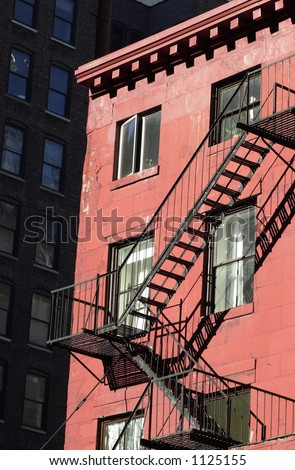 Fire Escape, Buildings in New York City - stock photo