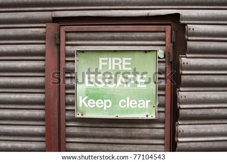 Fire escape door and sign - stock photo