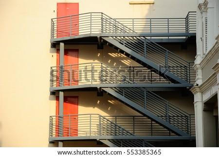 Apartment Building Fire Escape Ladder fire escape ladder stock images, royalty-free images & vectors