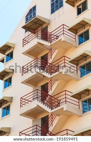 Fire escape ladder on the side of a building - stock photo