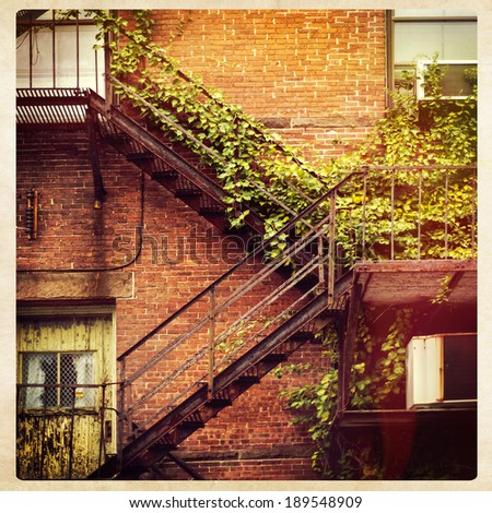 Fire escape on the facade of a red brick building, instagram style  - stock photo