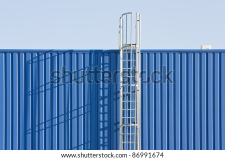 Fire escape on the metal wall - stock photo