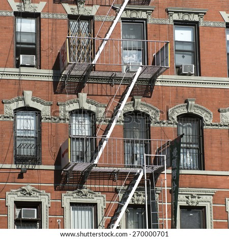 Fire Escape outside a building, Manhattan, New York City, New York State, USA - stock photo