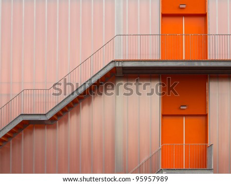Fire escape stairs on the outside of a modern sports hall - stock photo