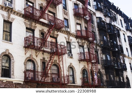 Fire escapes on buldings in Manhattan - stock photo