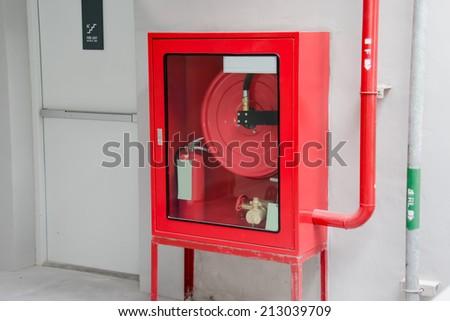 Fire exit door and fire extinguish equipment - stock photo