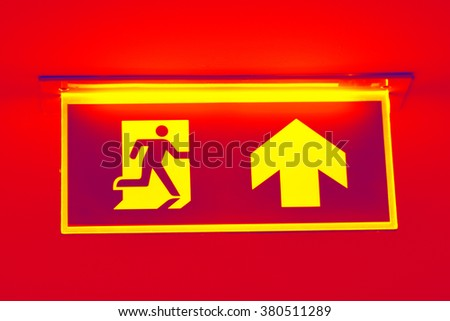 Fire Exit Sign with red theme background - stock photo