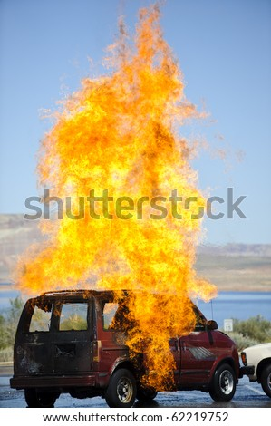 Fire explodes from a vehicle during a training exercise. - stock photo