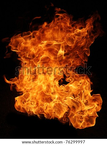 Fire explosion isolated on black background - stock photo