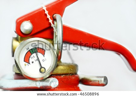 Fire extinguisher & emergency exit in workplace. - stock photo