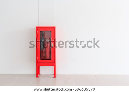 Fire Extinguisher in red Cabinet on Wall for fire protection in factory manufacturing with copy space.
