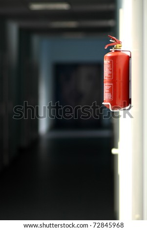Fire extinguisher in workplace - stock photo