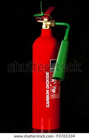 Fire extinguisher isolated on black background - stock photo