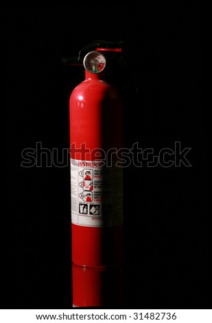 fire extinguisher on black with mirror for reflections - stock photo