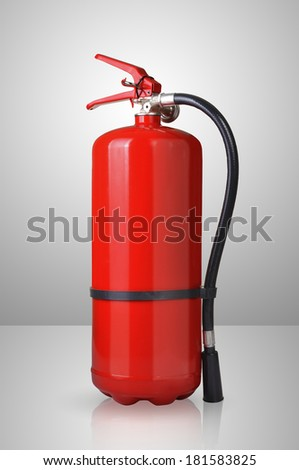 fire extinguisher on gray background  - stock photo