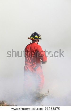 Fire Fighter Grass Fire Saskatchewan Canada - stock photo