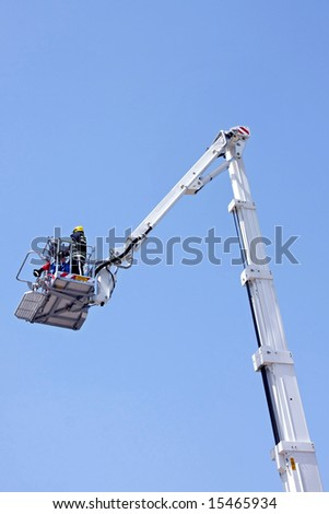 Fire fighter in tall and long crane