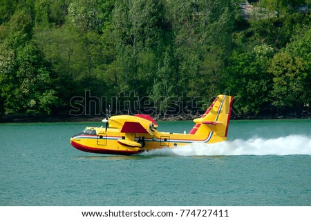 Fire fighter plane collect water on the lake