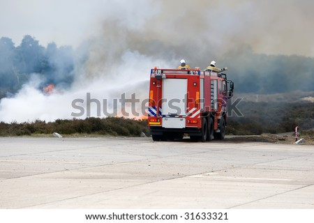 Fire fighters driving to the fire. - stock photo