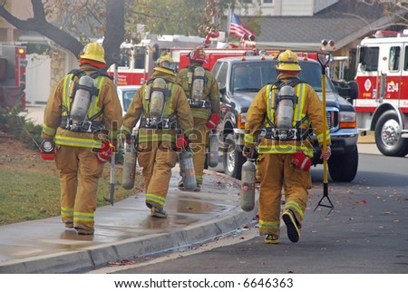 Fire Fighters Heading to a Fire - stock photo