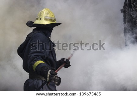 Fire-fighters in action - stock photo