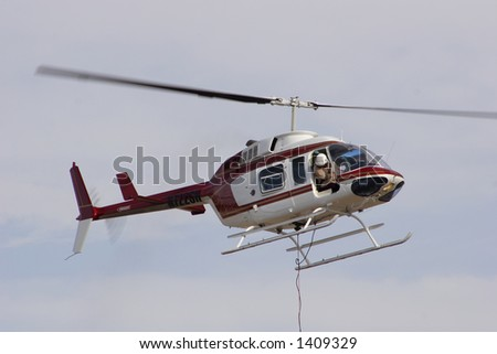 Fire fighting helicopter in flight - stock photo