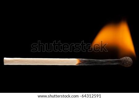 Fire flame heat burning wood match black isolated - stock photo
