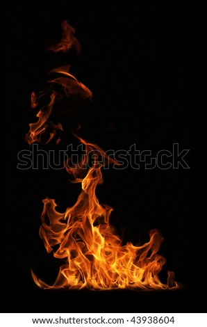 Fire flame isolated on black backgound - stock photo