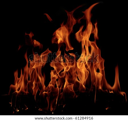 Fire flame isolated on black background - stock photo