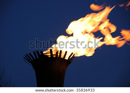 Fire flame of a torch at night, downtown edmonton, alberta, canada - stock photo