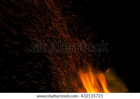Fire flames on a black background. Blaze fire flame texture background. Close up of fire flames isolated on black background. Burn. Abstract fire flames background. Texture. - stock photo