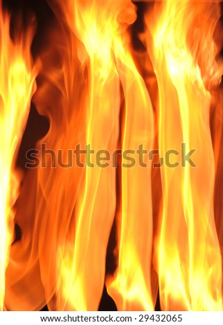 Fire flames raising in a dark background