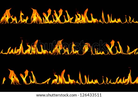 Fire flames set on dark background - stock photo