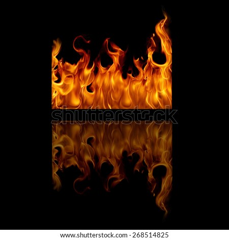 Fire flames with space for text on a black background  - stock photo