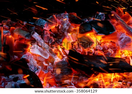 fire flames with sparks on the coals - stock photo