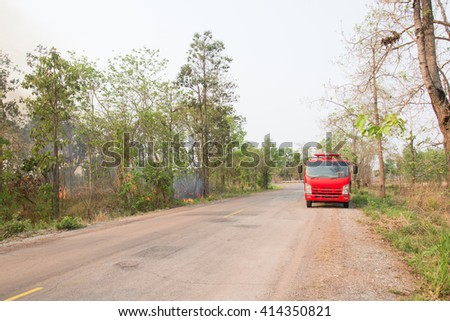 fire forest and fire truck - stock photo