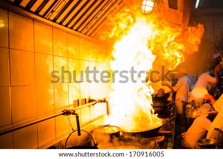 Fire gas burn is cooking on iron pan,stir fire very hot - stock photo
