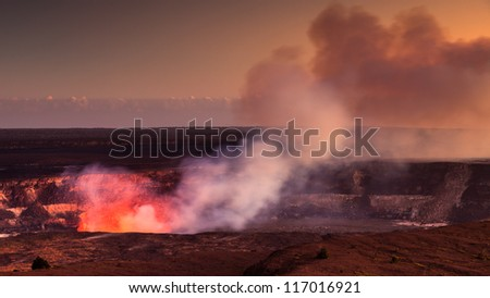 Fire glow coming out of the active Halemaumau crater in Volcanoes National Park, Hawaii Big Island. - stock photo