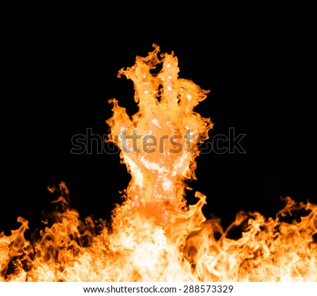 Fire hand rising from the fire. Fire hand on a black background. - stock photo