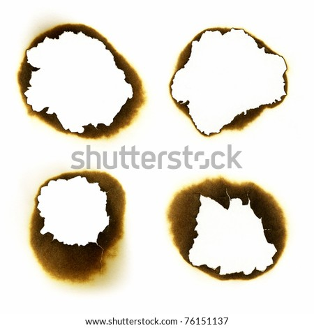 Fire holes in white paper - stock photo