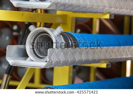 fire hose and adapter in fire truck - stock photo