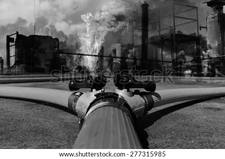 Fire hose connection ,fire fighting equipment for fire fighter black and white tone. - stock photo