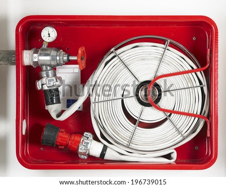 Fire hose equipment in a red metallic box. Horizontal - stock photo