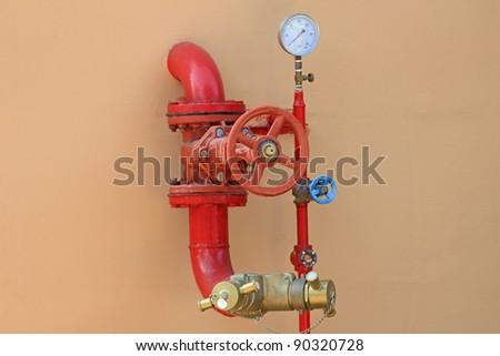 fire hose on a wall - stock photo