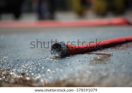 fire hose on the floor - stock photo