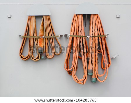 Fire hose on the wall - stock photo
