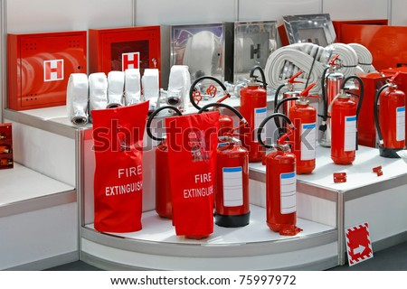 Fire hoses hydrants and extinguishers in red - stock photo