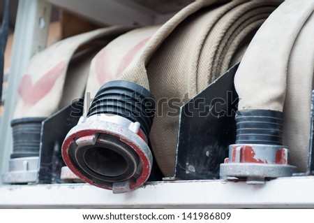 Fire hoses on a fire truck - stock photo